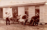 Picture relating to Charleville - titled 'Group of 'big kids' playing on a Charleville pie cart drawn by goats, ca. 1909'