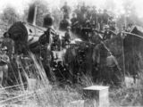 Picture relating to Eudlo - titled 'Railway workers posing with a derailed locomotive at Eudlo, 1914'