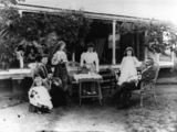 Picture relating to Queensland - titled 'Tea party in the garden, possibly at Nanango, 1900-1910'