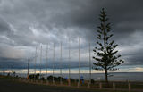Picture of / about 'Werribee South' Victoria - Storm brewing over new flagpoles at Werribee South