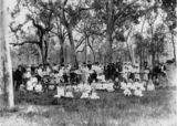 Picture relating to Nanango - titled 'Group portrait in Presbytery Paddock on Brooklands Road, Nanango, ca. 1911'