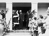 Picture relating to Barton - titled 'Santa Clause with Headmaster and children at Telopea Park School, New South Wales Crescent, Barton.'