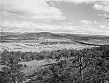 Picture relating to Black Mountain - titled 'Braddon and Civic Centre from Mt Ainslie. Ainslie Hotel in the centre. Black Mountain at the rear.'