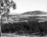 Picture relating to Ainslie - titled 'Braddon and Civic Centre from Mt Ainslie. Ainslie Hotel in centre. Black Mountain at the rear.'