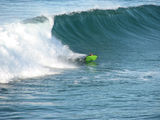 Picture of / about 'Tuross Head' New South Wales - Boogie Boarder surfing the 3m high break off Tuross Head