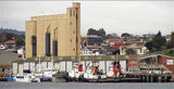 Picture relating to Devonport - titled 'Devonport Tug boat base in Mersey River and Cement silo'