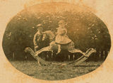 Picture relating to Mackay - titled ''Paddy' and 'Plum Bun' playing with a rocking horse in the garden at The Hollow, ca. 1878'