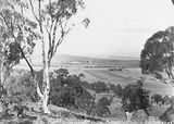 Picture relating to Ainslie - titled 'Anzac Parade, St John's Church and Old Parliament House from Mt Ainslie.'