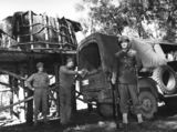 Picture relating to Queensland - titled 'Soldiers filling a truck with petrol, south east Queensland, 1942'