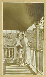Picture of / about 'Samford' Queensland - Two young ladies and a small girl are standing on a verandah at Samford, ca. 1925