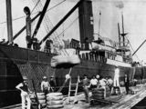 Picture relating to Brisbane - titled 'Bales being loaded onto a ship docked at Musgrave Wharf, Brisbane, Queensland, 1908'