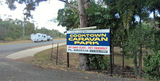 Picture relating to Cooktown - titled 'Cooktown Caravan Park entrance'