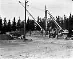 Picture relating to Queanbeyan - titled 'Construction site with Gantry Crane marked Mason, Builder, Queanbeyan.'