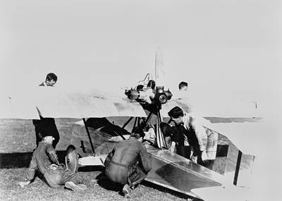 Picture of / about 'Richmond' New South Wales - Aircraft mechanics preparing the Warbler aeroplane, during light aircraft trials, December 1924