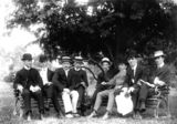 Picture relating to Queensland - titled 'Group of young men relaxing in a park, 1900-1910'