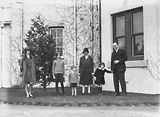 Picture relating to Acton - titled 'Sir John Butters and family outside Canberra House, Acton.'