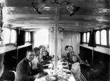 Picture relating to Queensland - titled 'Family group dining on board, 1910-1920'