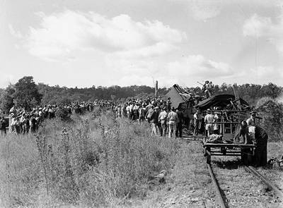 Picture of / about 'Camp Mountain' Queensland - Relief workers inspect the wreckage after railway accident at Camp Mountain, Queensland, 1947