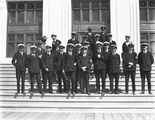 Picture relating to Parliament House - titled 'Visit to Canberra of Royal Navy Officers from HMS Renown - Party on the steps of Old Parliament House'