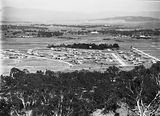 Picture relating to Ainslie - titled 'Reid from Mt Ainslie. Glebe House in centre.'