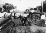 Picture of / about 'Highgate Hill' Queensland - Three milkmen pose with horse and cart in Highgate Hill, Brisbane, ca. 1914