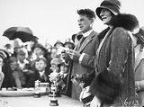 Picture relating to Canberra - titled 'Reverend Doctor William John Edwards, Headmaster of Canberra Grammar School with Lady Stonehaven, wife of the Govenor General with trophies for the School Sports Day at Manuka Oval.'