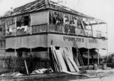 Picture relating to Mackay - titled 'Building damaged in a cyclone in Mackay, 1918'