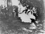 Picture of / about 'Fraser Island' Queensland - Ruby Byrne and Irene Askew reading outdoors in the shade, Fraser Island, ca. 1903
