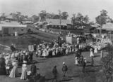 Picture relating to Beaudesert - titled 'Empire Day procession on the corner of Brisbane and William Streets, Beaudesert, 1908'