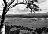 Picture relating to Ainslie - titled 'View from slopes of Mt Ainslie towards Old Parliament House'