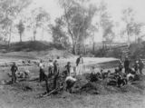 Picture relating to Anakie - titled 'Men and children sieving for sapphires at Anakie, Queensland, 1913'