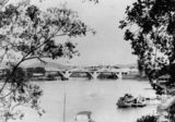 Picture relating to Brisbane River - titled 'Looking towards the William Jolly Bridge from the riverbank at South Brisbane, ca. 1934'