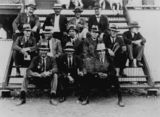 Picture relating to Winton - titled 'Winton Race Committee, seated on the steps of the grandstand, Winton, Queensland'
