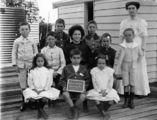 Picture relating to Sandy Cape - titled 'Group portrait of students from Sandy Cape Provisional School, Fraser Island, ca. 1910'