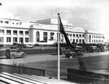 Picture relating to Parliament House - titled 'Royal Visit, May 1927 - Front of Old Parliament House with motor cars during rehearsals.'