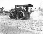 Picture of / about 'Parliament House' the Australian Capital Territory - Steam roller with attached tar spray at work making roads near Old Parliament House