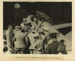 Picture relating to Charleville - titled 'Pilot Scott checking his fuel with a group of officials, Charleville, 1934'