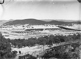 Picture relating to Red Hill - titled 'Kingston, Griffith and Red Hill from Mt Ainslie. Molonglo River through the centre.'