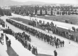 Picture relating to Isaacs - titled 'Anzac Day 1933. Returned Servicemen marching past the Govenor General, Sir Isaac Isaacs, in front of Old Parliament House.'