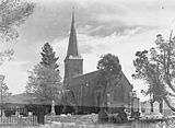 Picture relating to Reid - titled 'St Johns Church and graveyard, Constitution Avenue, Reid from Anzac Parade.'