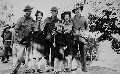 Picture of / about 'Brisbane' Queensland - Group of soldiers, three men and two women, celebrating V.J. Day (Victory in Japan) in the Botanic Gardens, Brisbane