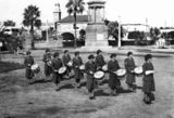 Picture relating to Warwick - titled 'Ladie's band playing drums in Leslie Park, Warwick, ca. 1943'