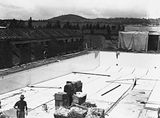 Picture relating to Kingston - titled 'Manuka swimming pool under construction, tiling of the floor, Manuka Circle, Kingston.'