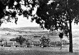 "Picture relating to Parkes - titled 'View from Red Hill towards Duntroon - Hotel Wellington in centre. under construction. Oakley and Parkes "" Forrest Park ""homes in foreground.'"