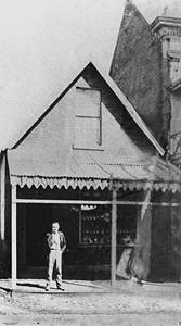 Picture of / about 'Brisbane' Queensland - James Davis poses in front of his crockery store, George Street, Brisbane, ca. 1872