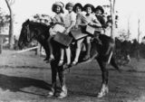 Picture relating to Glass House Mountains - titled 'Children riding a horse to school, Glass House Mountains, Queensland, 1928'