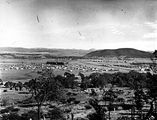 Picture relating to Ainslie - titled 'Reid, Braddon and Civic Centre from Mt Ainslie, Ainslie Hotel on the right.'