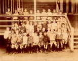 Picture relating to Queensland - titled 'School boys posing for a photograph on the front verandah of the school building, 1900-1910'