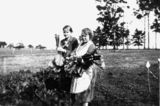 Picture relating to Queensland - titled 'Two women picking rhubarb, ca. 1930'