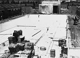 Picture relating to Manuka - titled 'Manuka swimming pool under construction, floor of the pool being placed, Manuka Circle, Kingston.'